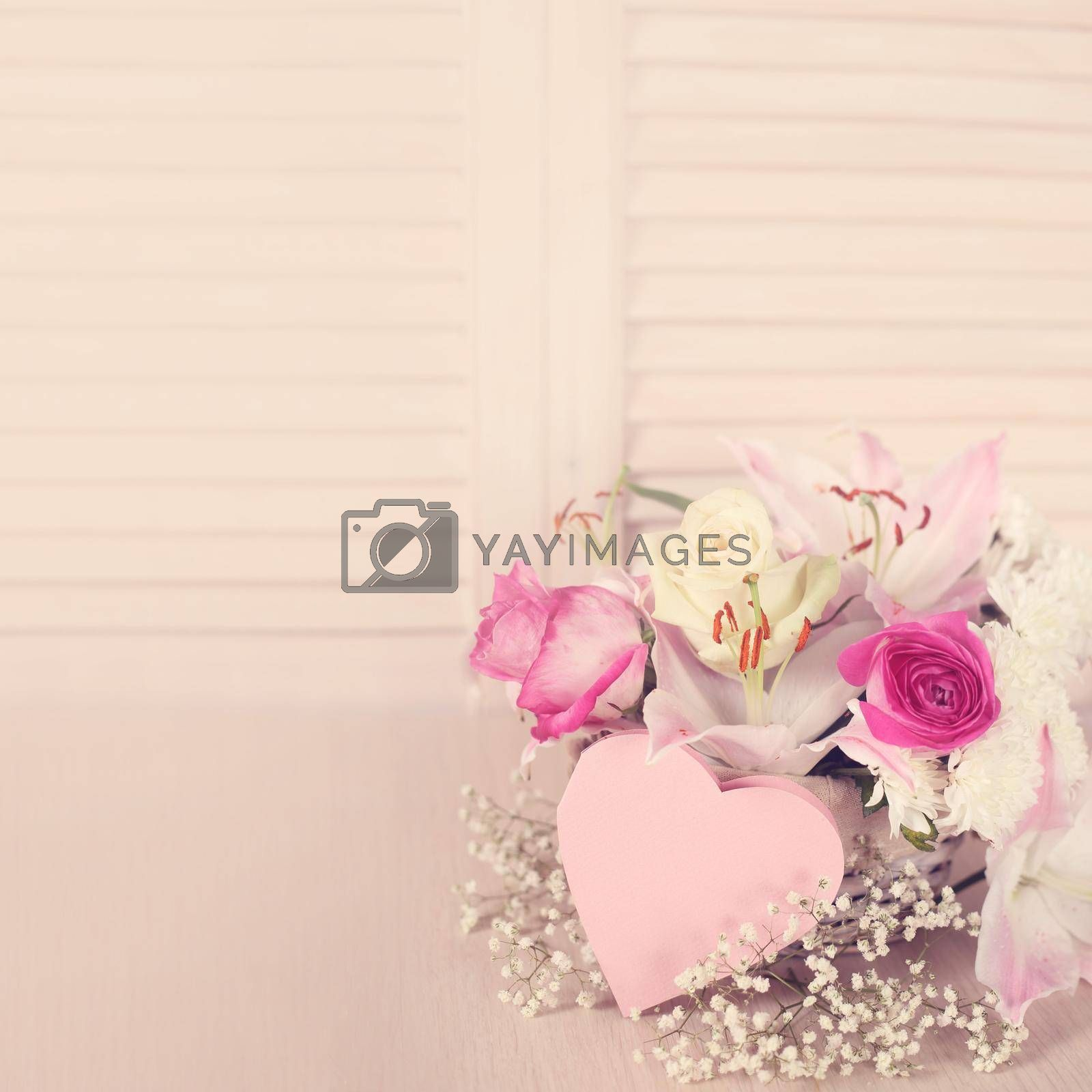Valentines day flowers in basket and heart shape card
