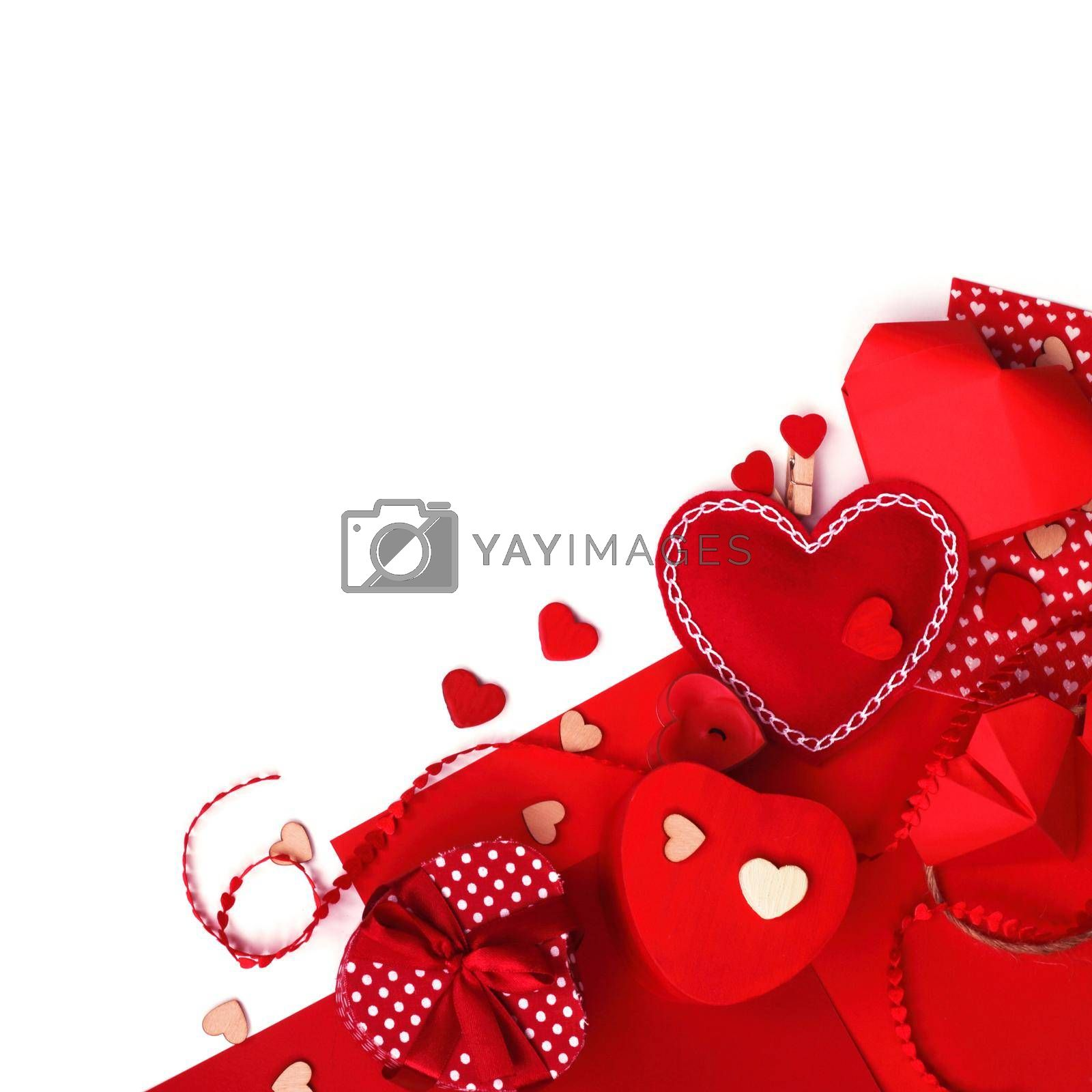 Many valentine day hearts and decor, homemade craft concept, red fabric, paper, gifts and candles, isolated on white background copy space for text