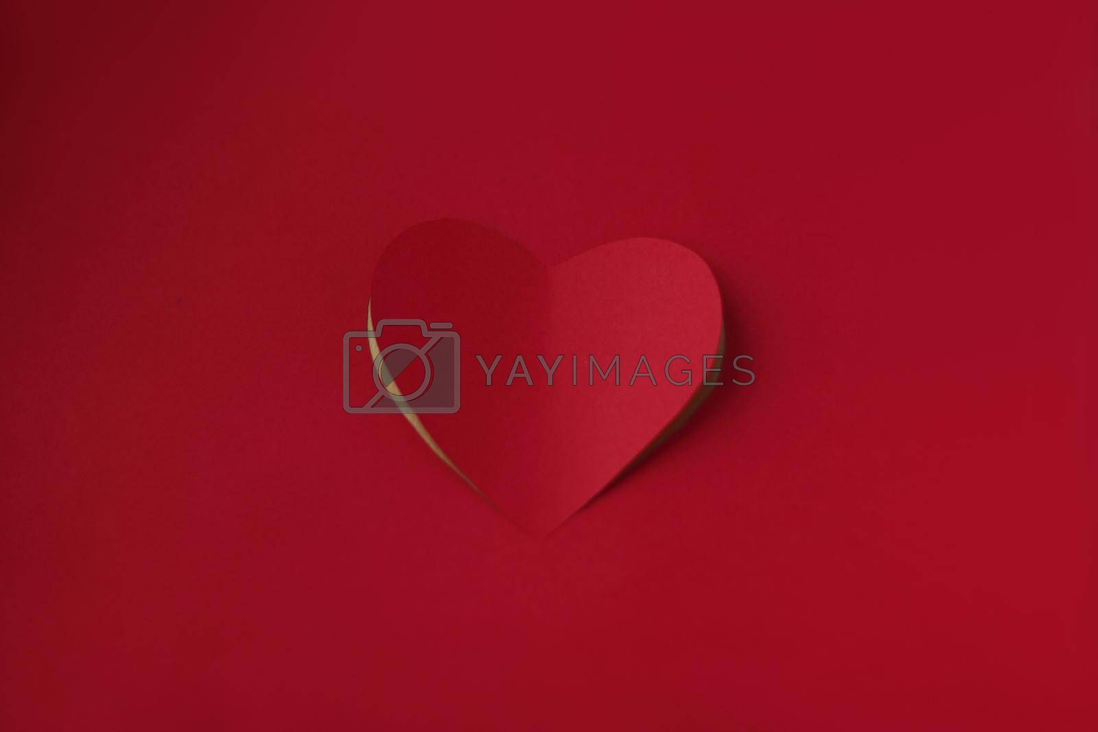 Heart cut from red paper background, Valentines day card