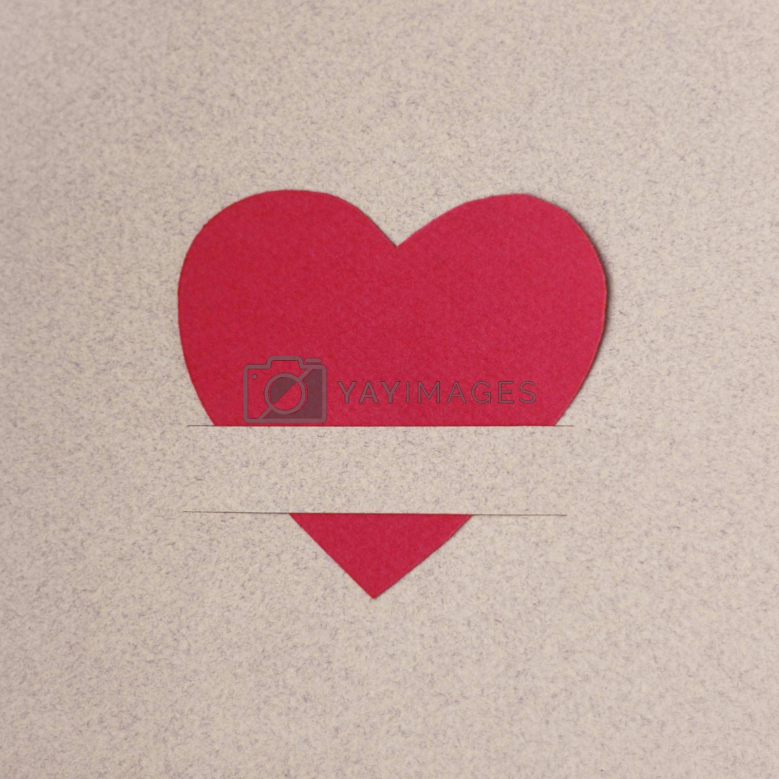 Red paper hearts on light paper textured background