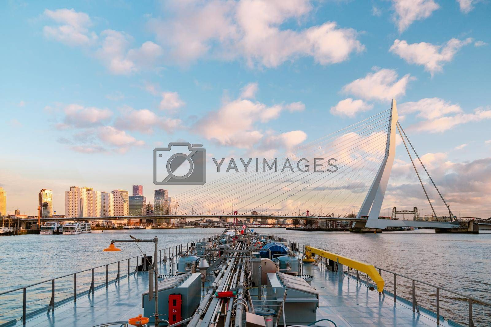 Binnenvaart, Translation Inlandshipping on the river Nieuwe Maas Rotterdam Netherlands during sunset hours, Gas tanker vessel Rotterdam oil and gas transport. Netherlands