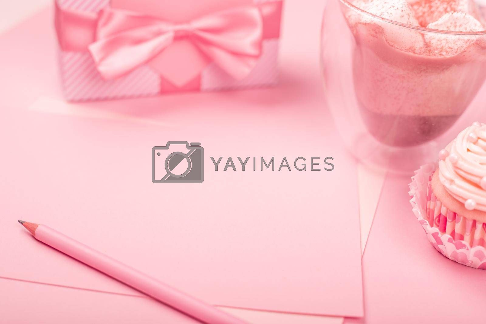 Valentine day love letter paper cupcake decorated with cream gift and hearts on pink background with copy space for text