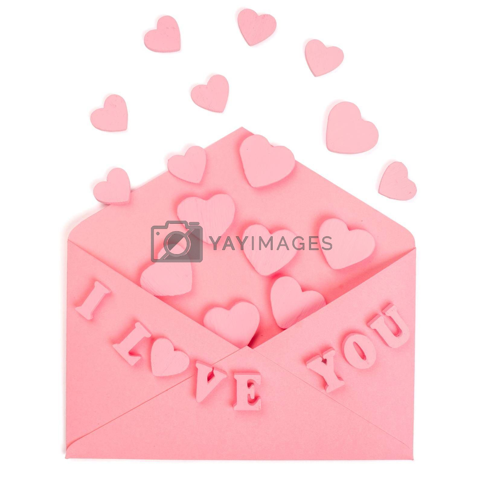 Pink love letter and wooden painted hearts and I love you letters isolated on white background