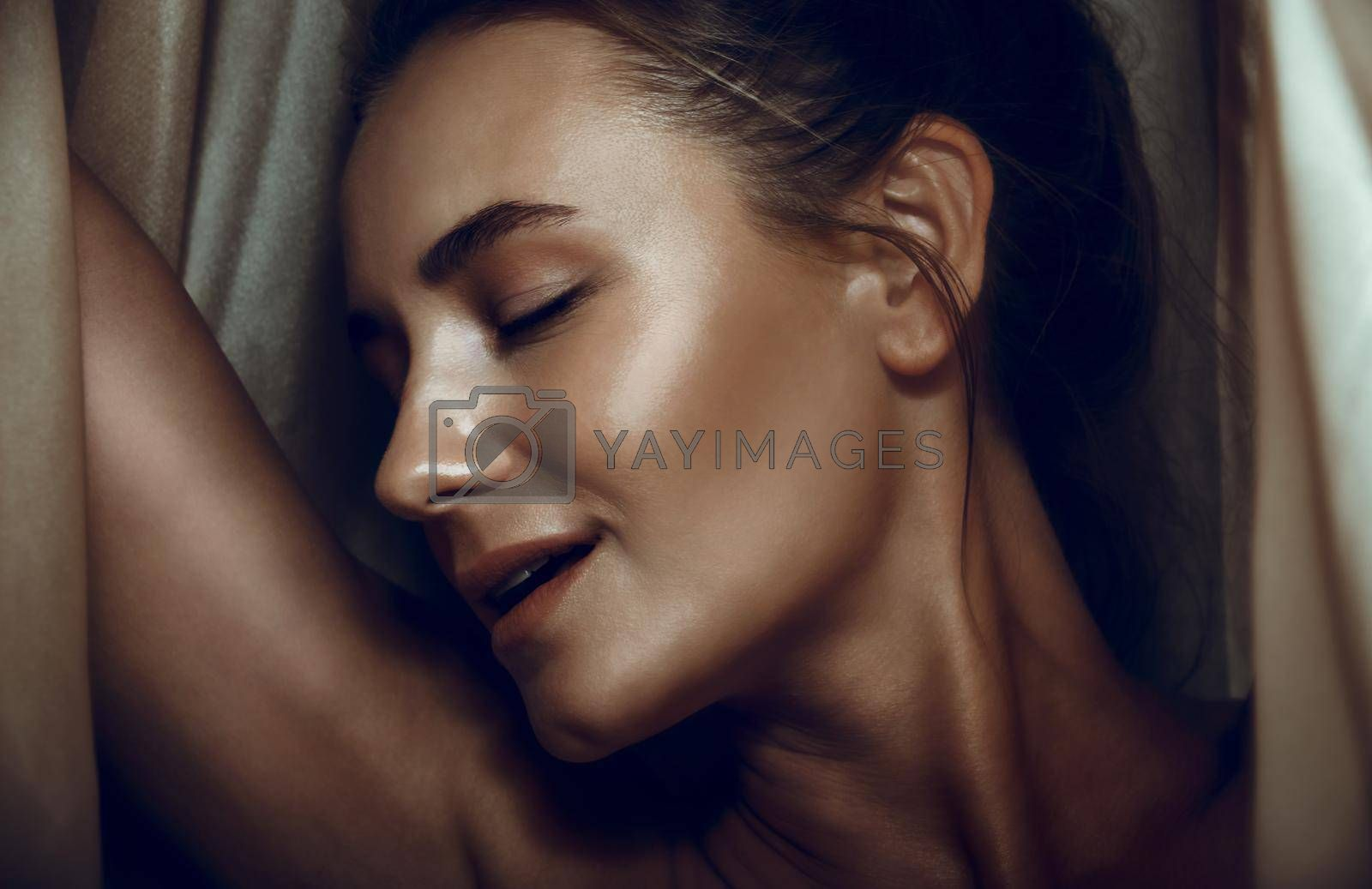 Closeup Face Portrait of a Seductive Woman with Closed Eyes. Authentic Beauty of the Female Sensuality. Fashion Look.