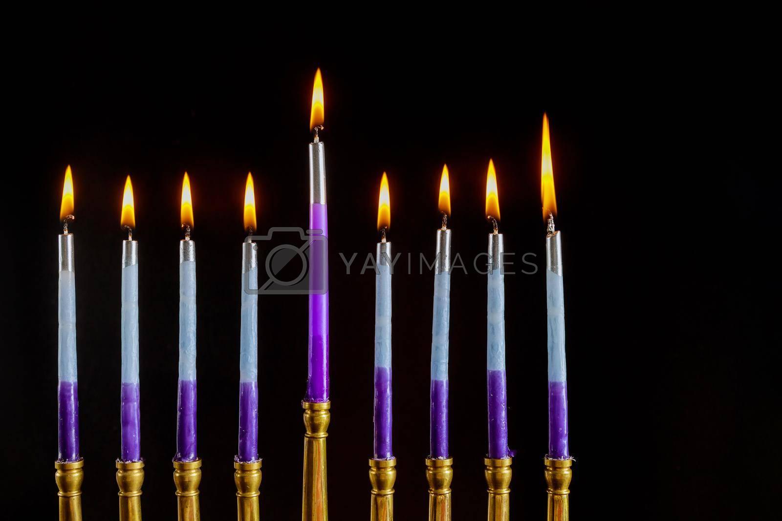 Jewish Religion holiday symbol in hanukkiah Menorah with burned out candles for Hanukkah