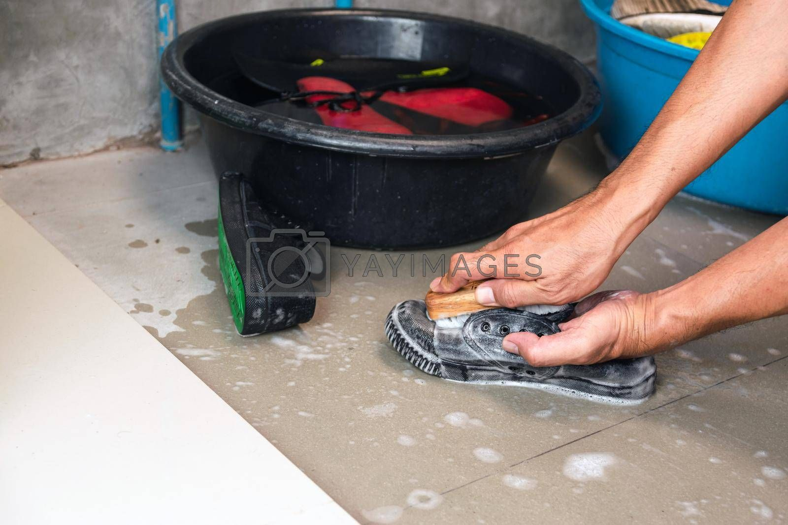 Wash the sneakers with a washing brush and washing powder.