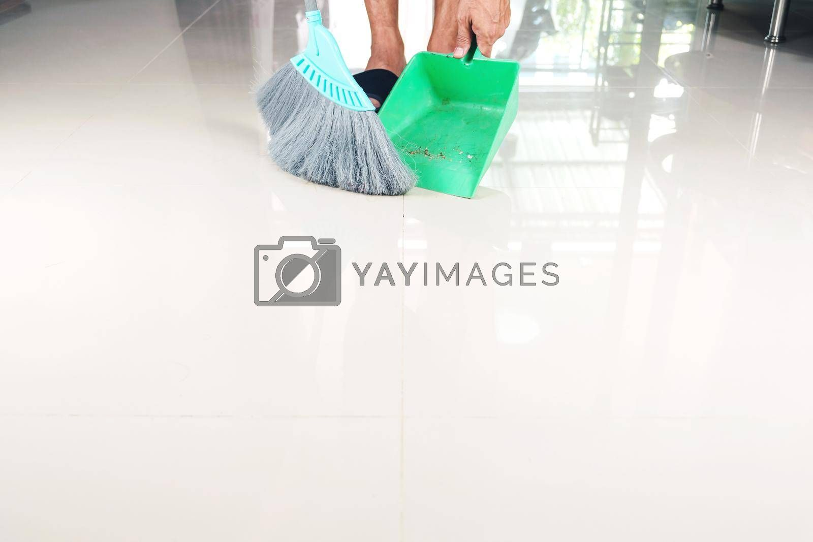 Clean tiled floors with a plastic broom and dustpan.