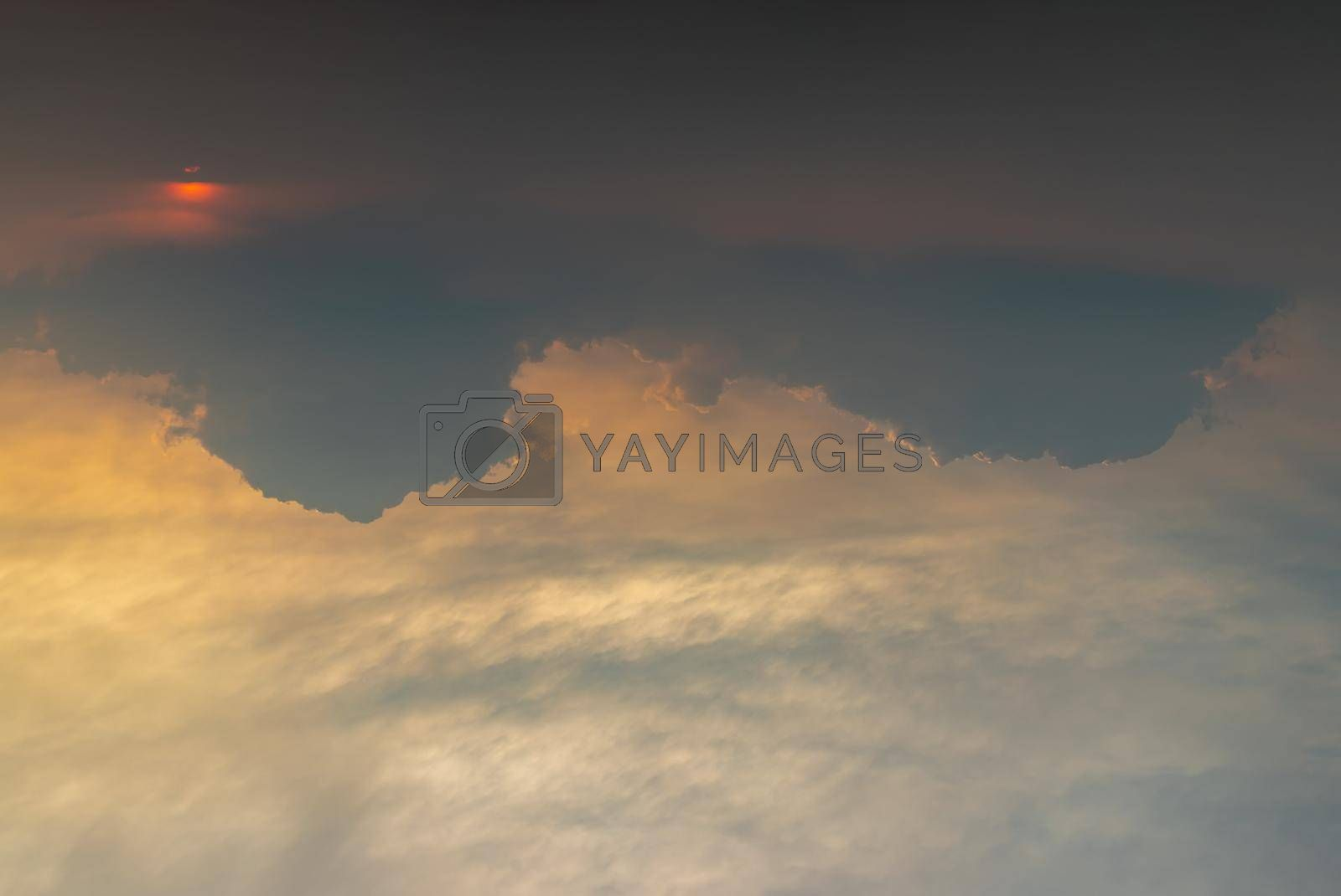Beautiful sunset sky above clouds with dramatic light, Beautiful blazing sunset landscape, Horizon. Warm Colours, copy space, No focus, specifically.