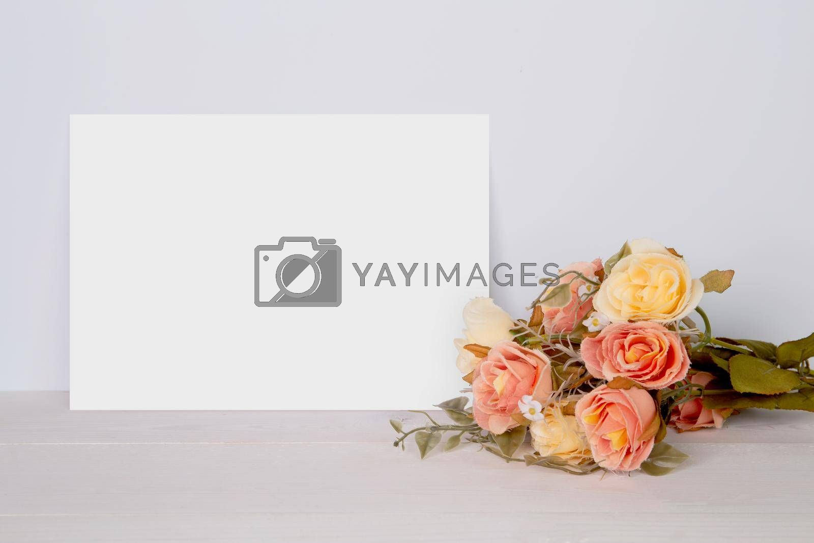 Valentine day, greeting card mockup empty and flower on wooden table, postcard blank with romance on desk, present in anniversary and celebration, paper for message with vertical, holiday concept.