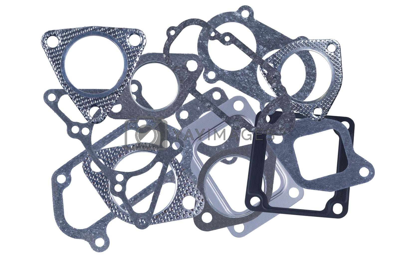 Set of several different metal and paronite engine gaskets, isolated on a white background