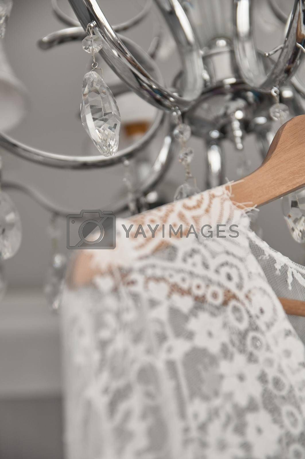 wedding peignoir hanging on the chandelier in the room