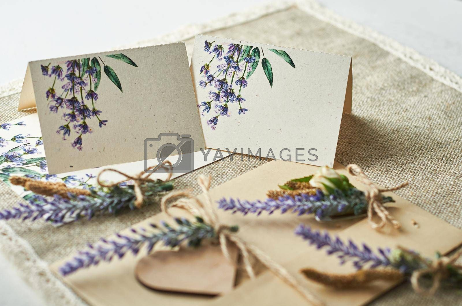 cards for lettering names blank, envelope on table with lavender flower
