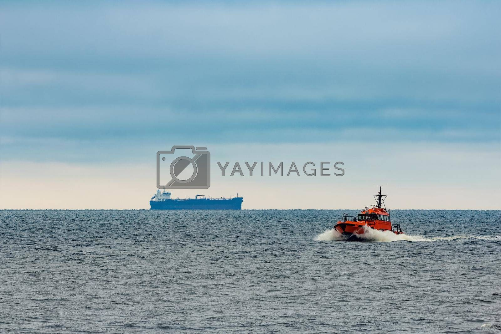 Red pilot ship moving at speed in Baltic sea