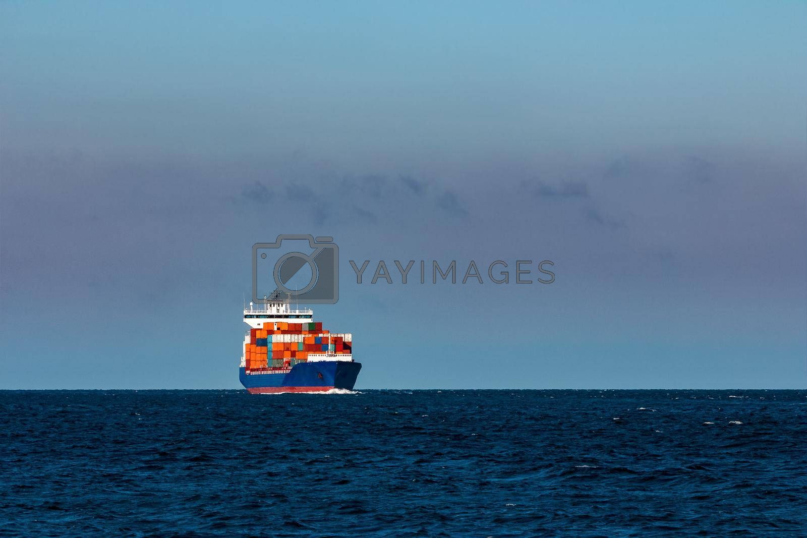 Blue container ship. Logistics and production transfer in Europe