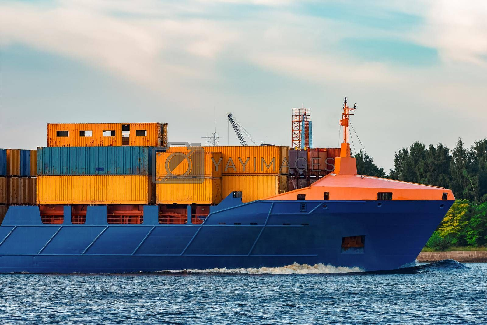 Blue container ship. Global logistics and merchandise transfer