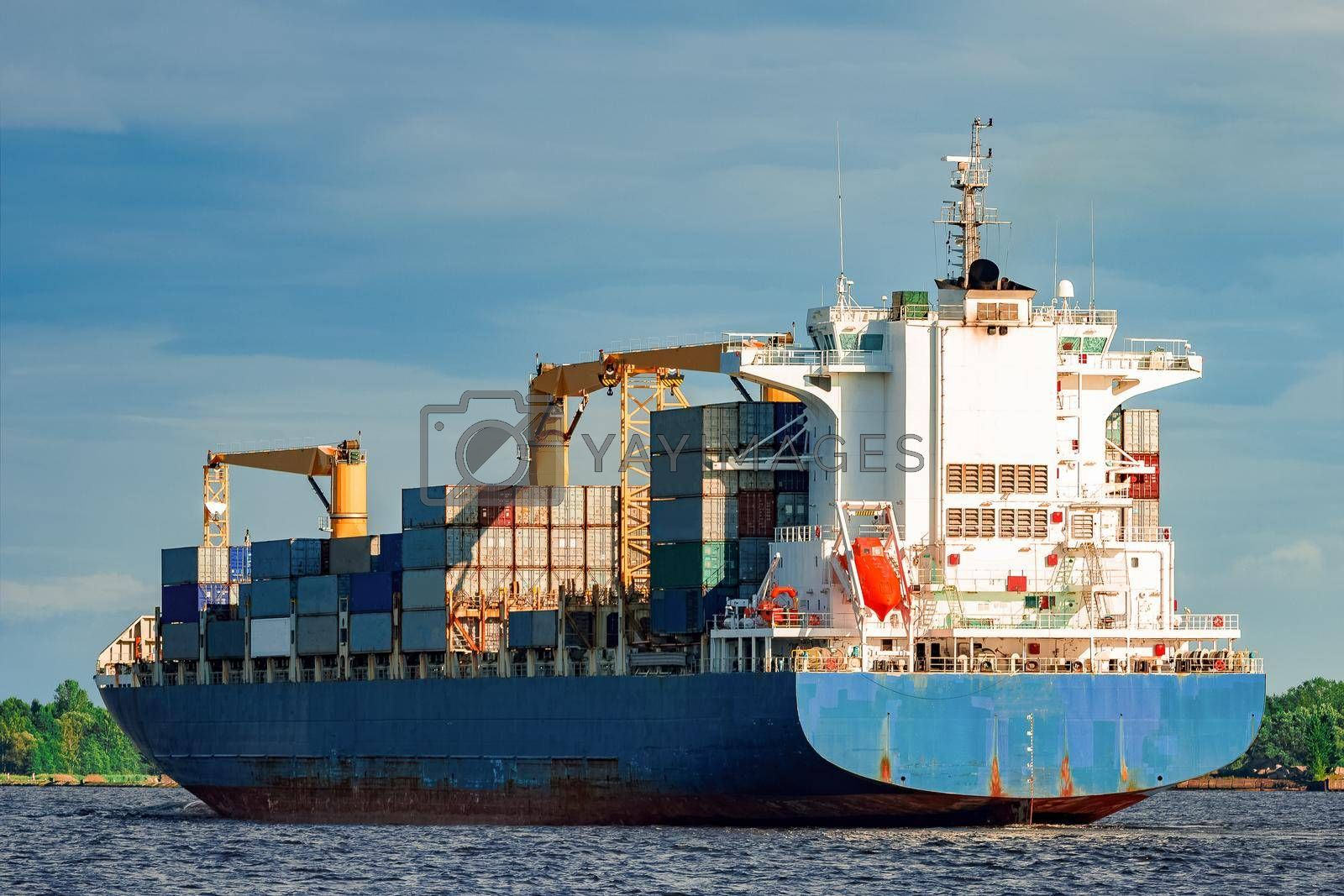 Blue container ship. World logistics and production transfer