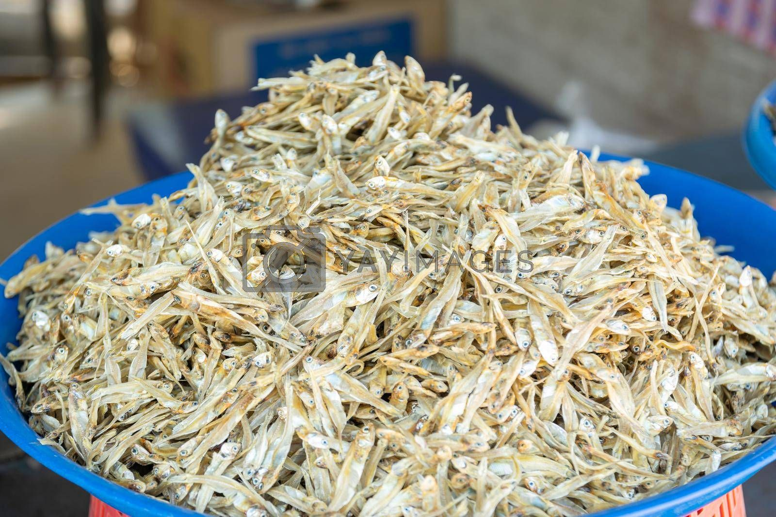 Group of small sea fish dried for sale to tourists in the market.