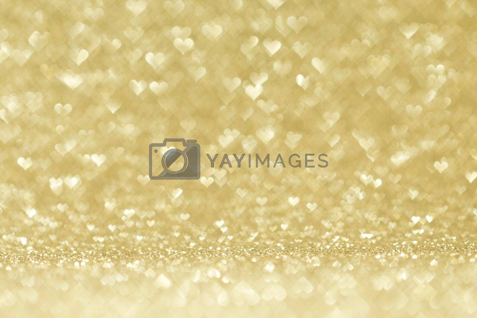 Valentines day abstract background with golden heart shape bokeh lights
