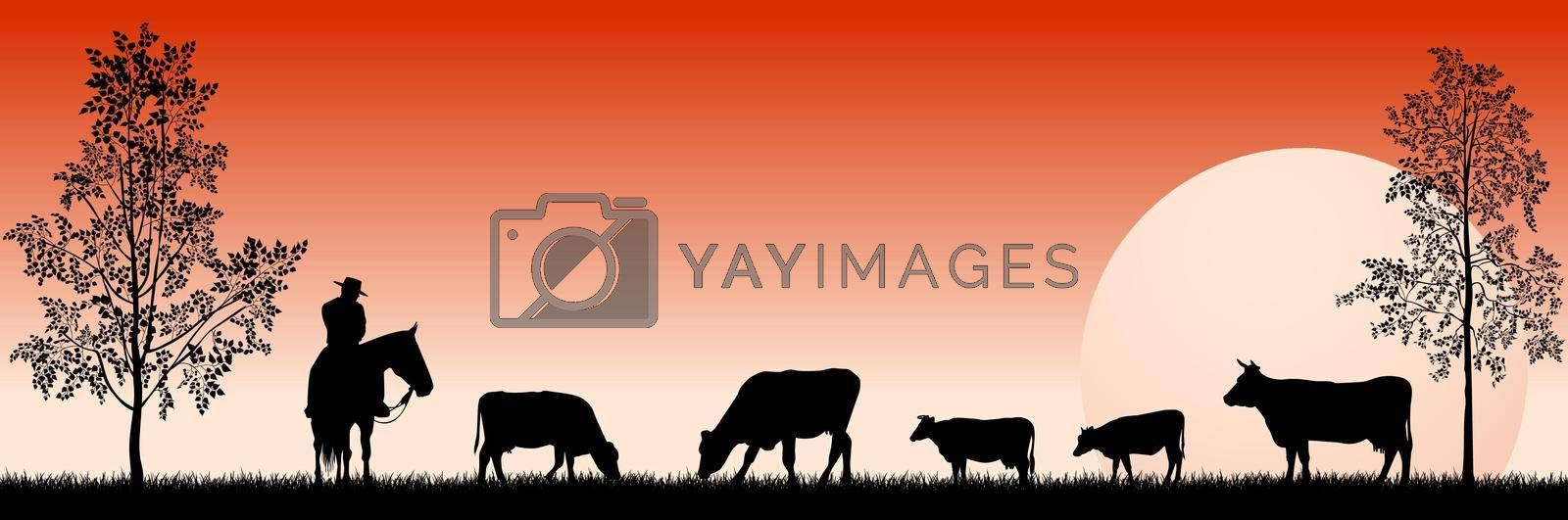 Royalty free image of Cowboy and grazing cows in the meadow by liolle