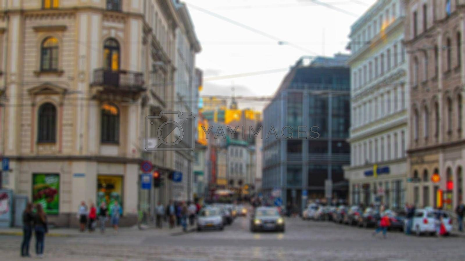 Royalty free image of Blurred background of a city street. Urban landscape. Creative theme with blur and bokeh effect for backgrounds, posters, screensavers. by Grommik