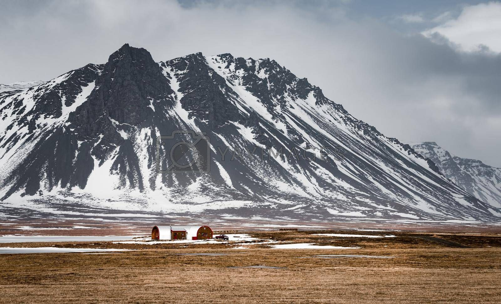 Amazing Winter View on the Snowy High Mountains. Extreme Nature Travel Destination. Picturesque Landscape of Icelandic Lands.