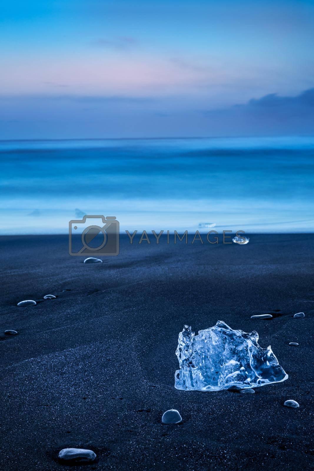 Beautiful Landscape of a Black Volcanic Sand Beach with Icebergs. Serene Nature of Vatnajokull Jokulsarlon. Iceland.