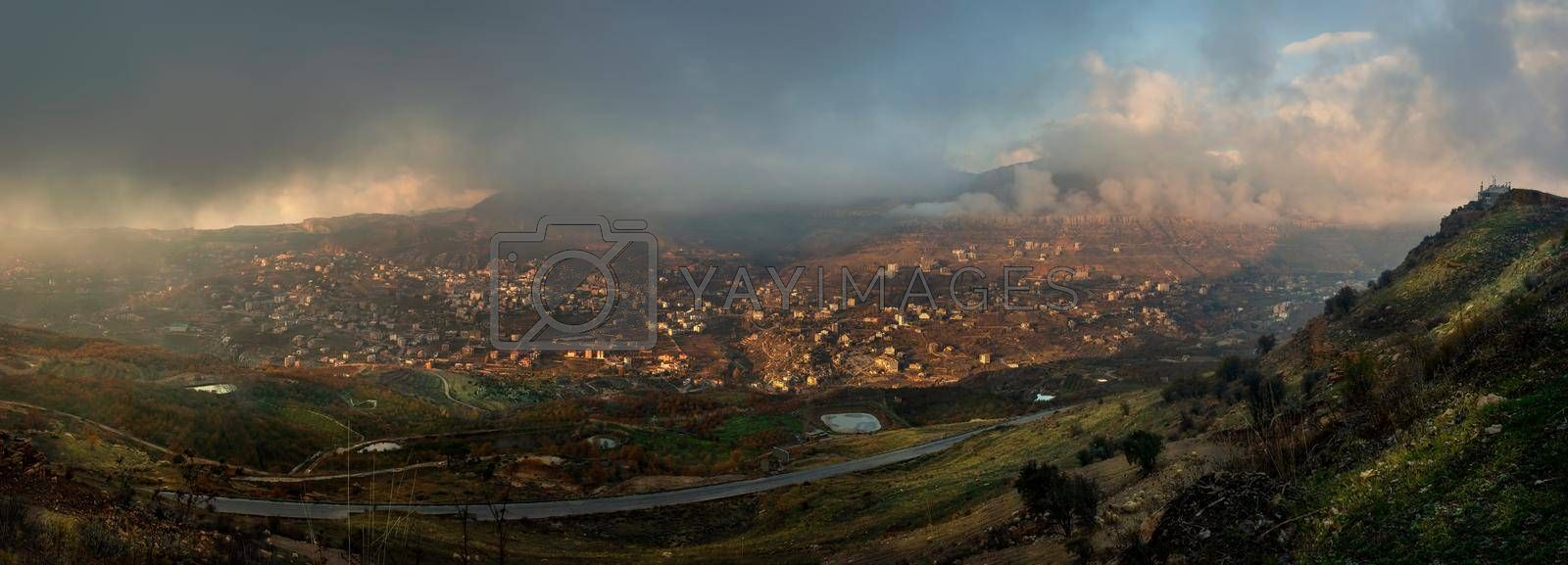 Panoramic View of the Beautiful Valley. Mountainous Town Covered with Clouds. Lebanon.
