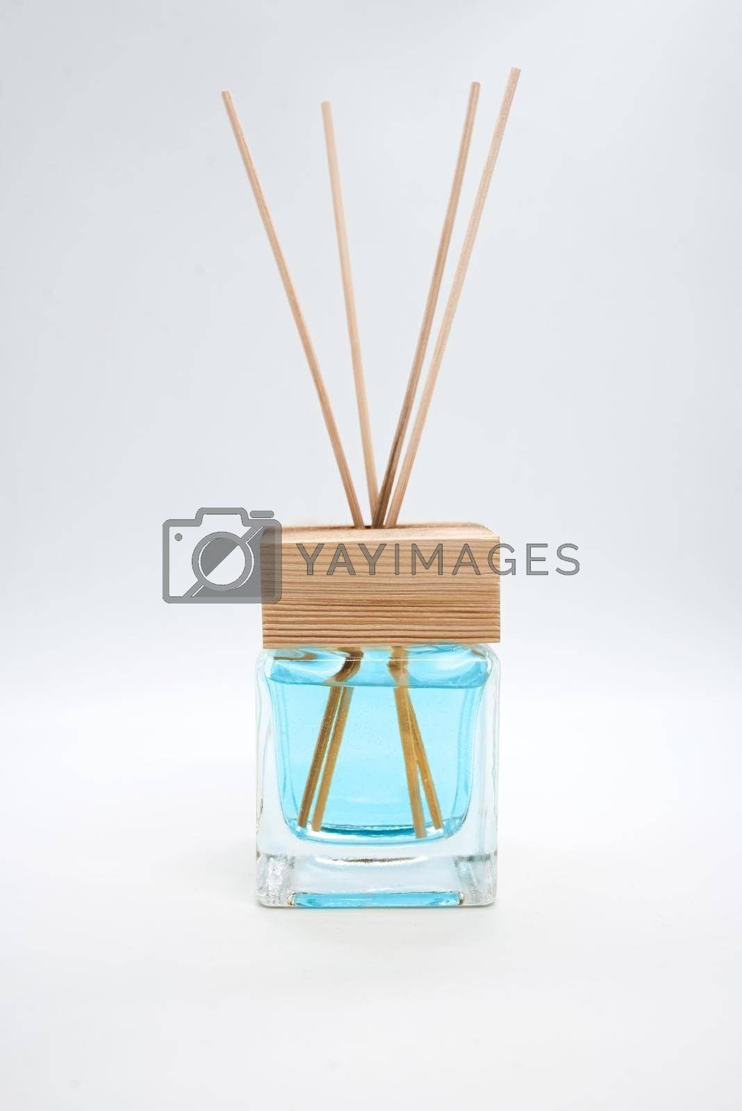 A Bottle of Lavender Fragrant Oil Diffuser with Reed Sticks, isolated on white by Nickstock