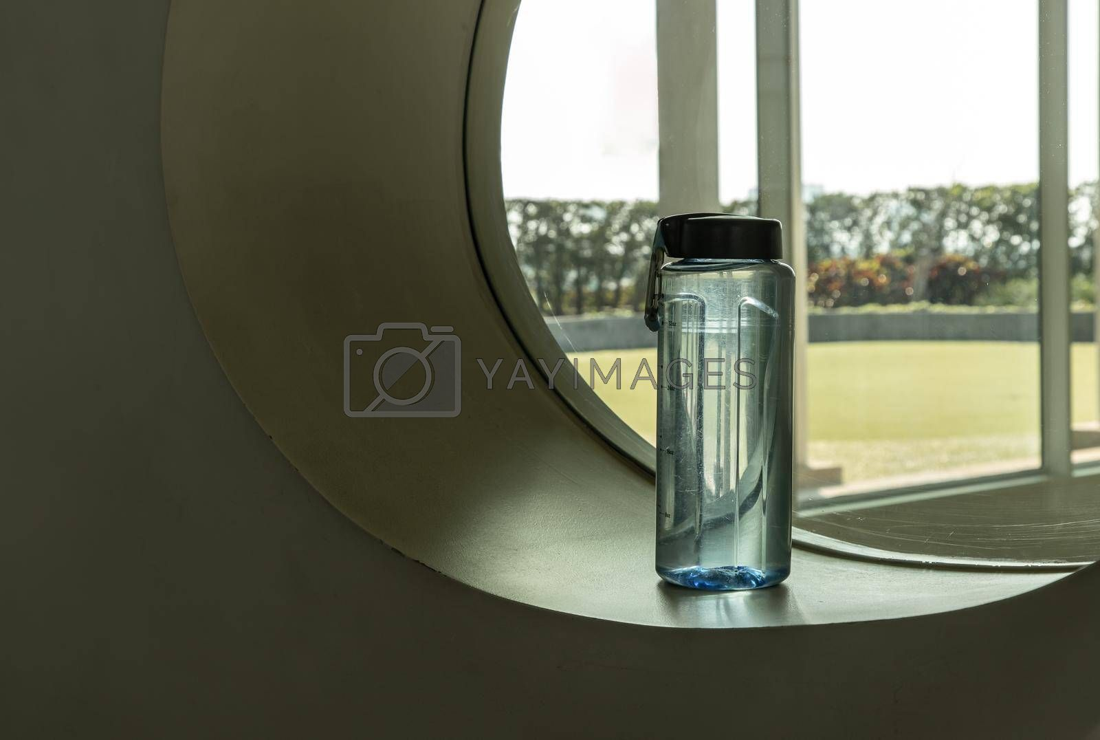 Sport water bottle in sport club or gym and fitness room with free space. Gym concept. Selective focus.