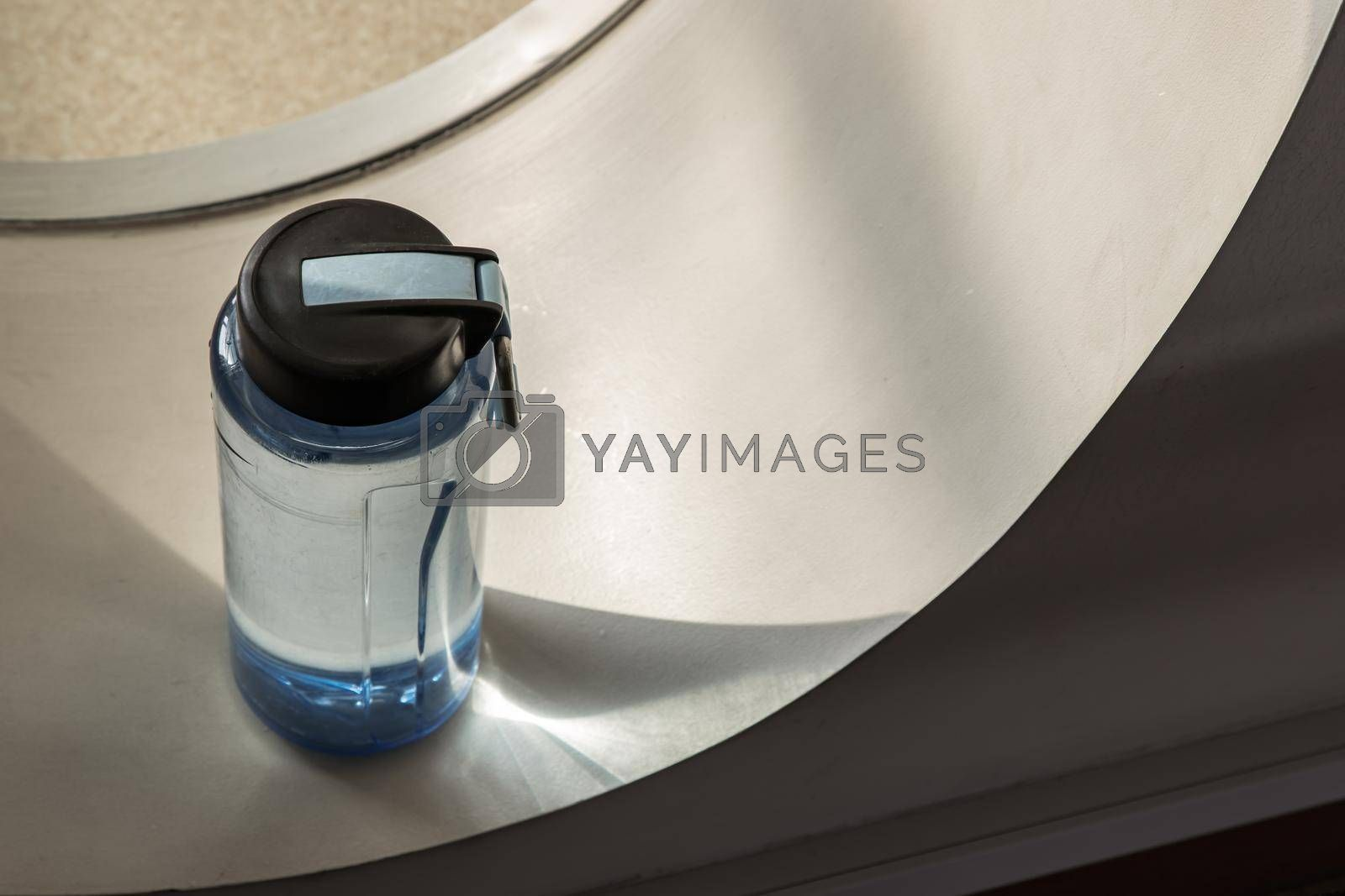 Top view of Sport water bottle in sport club or gym and fitness room with free space. Gym concept. Selective focus.
