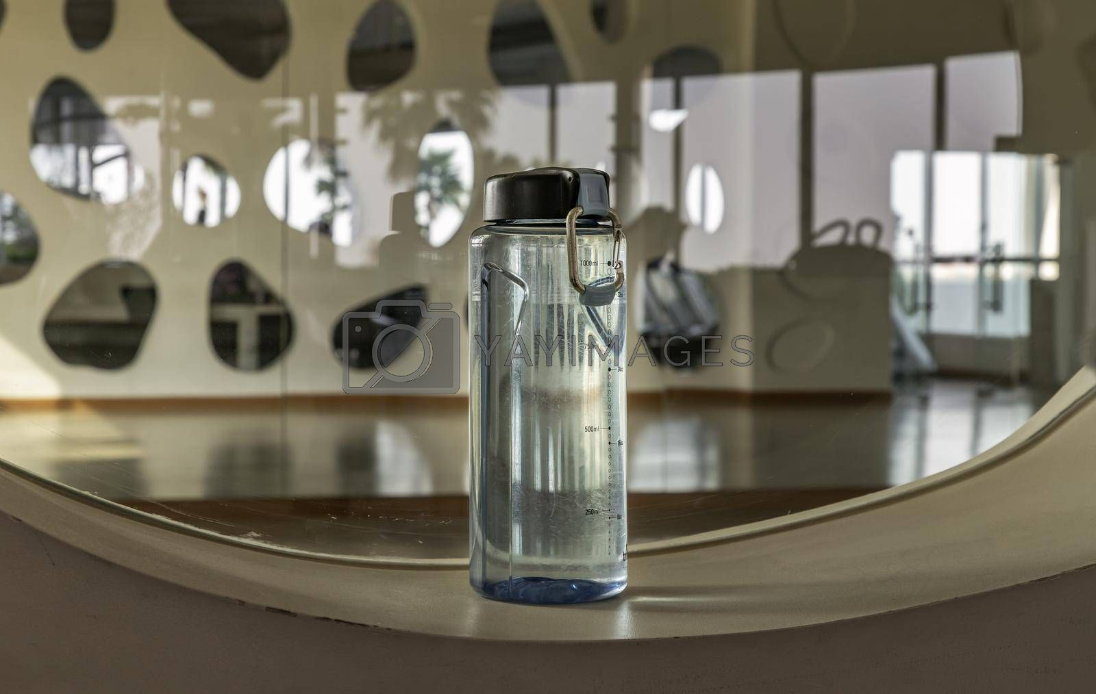 Bangkok, Thailand - 24 Jan 2021 : Sport water bottle in sport club or gym and fitness room with free space. Gym concept. Selective focus.
