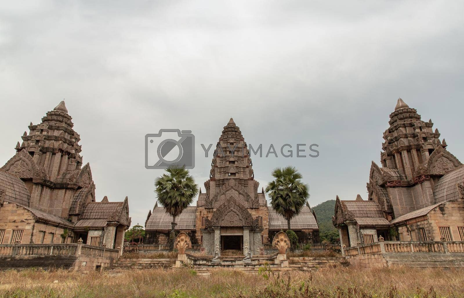 Facade of Old ruined abandoned Mansion view. A historic mansion inspired by the Cambodian of Angkor Wat. Selective focus.
