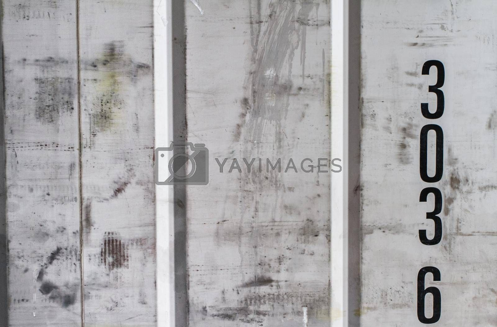 Aluminum wiped sheet of metal with numeric designations. Figures on metal.