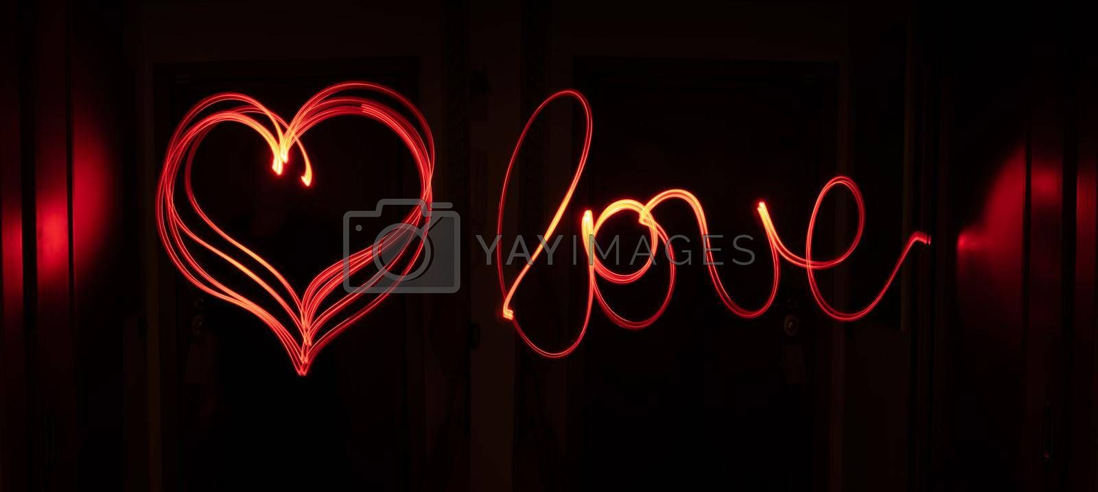 Royalty free image of Red light track writing love and drawing a heart. by maramade