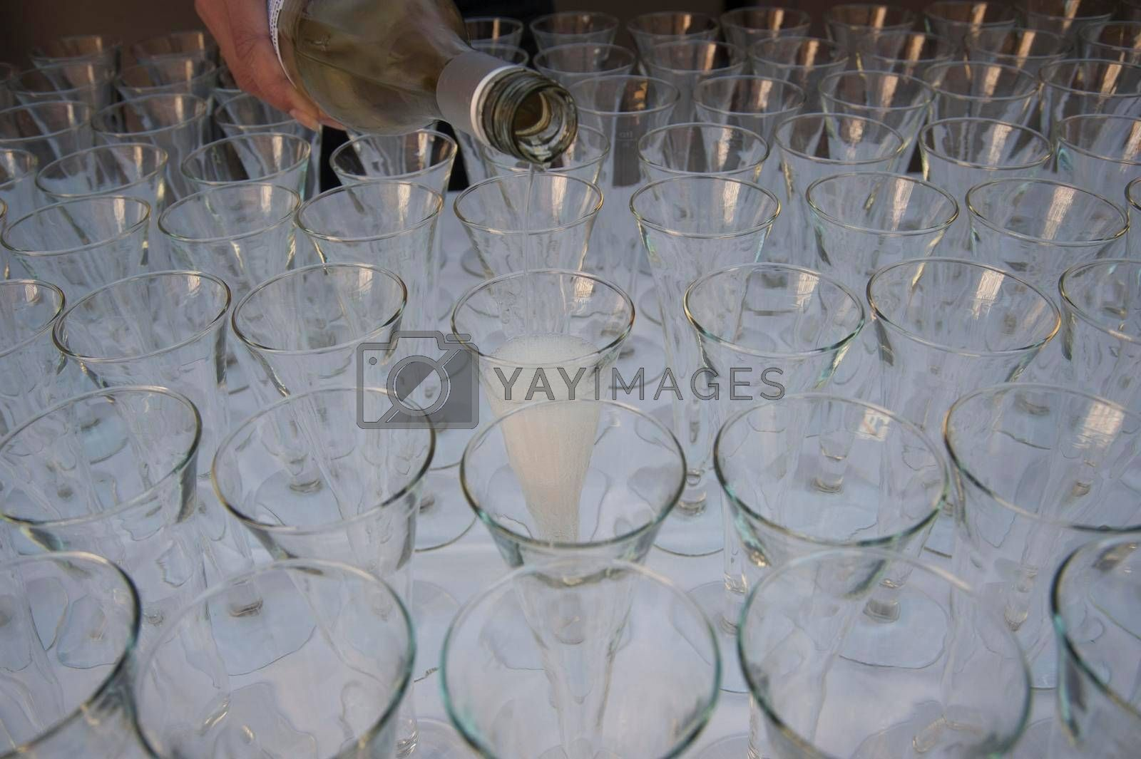 pouring champagne into champagne glasses, alcoholic beverage for festive occasions