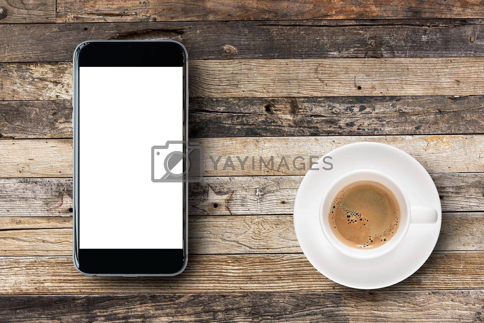 Flat lay Smartphone with blank white screen and coffee cup on wooden table background. Elegant Design for mock up, montage your design and products.