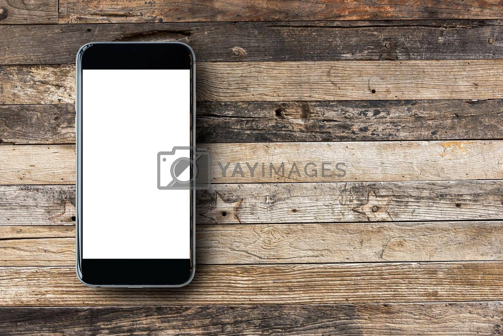 Flat lay Smartphone with blank white screen and copy-space on wooden table background. Elegant Design for mock up, montage your design and products.
