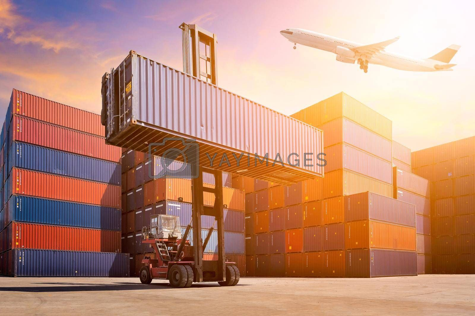 Flight cargo flying over Logistic cargo container in shipping yard. Photo concept for Global business shipping,Logistic,Import and Export industries.