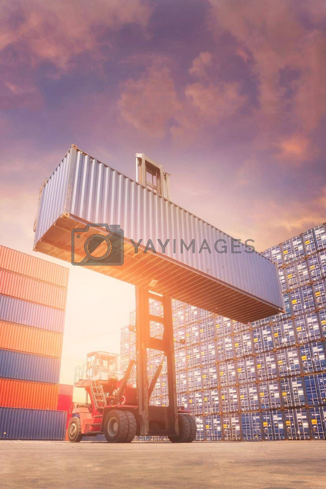 Forklift truck lifting cargo container in shipping yard for transportation import,export and logistic industrial concept