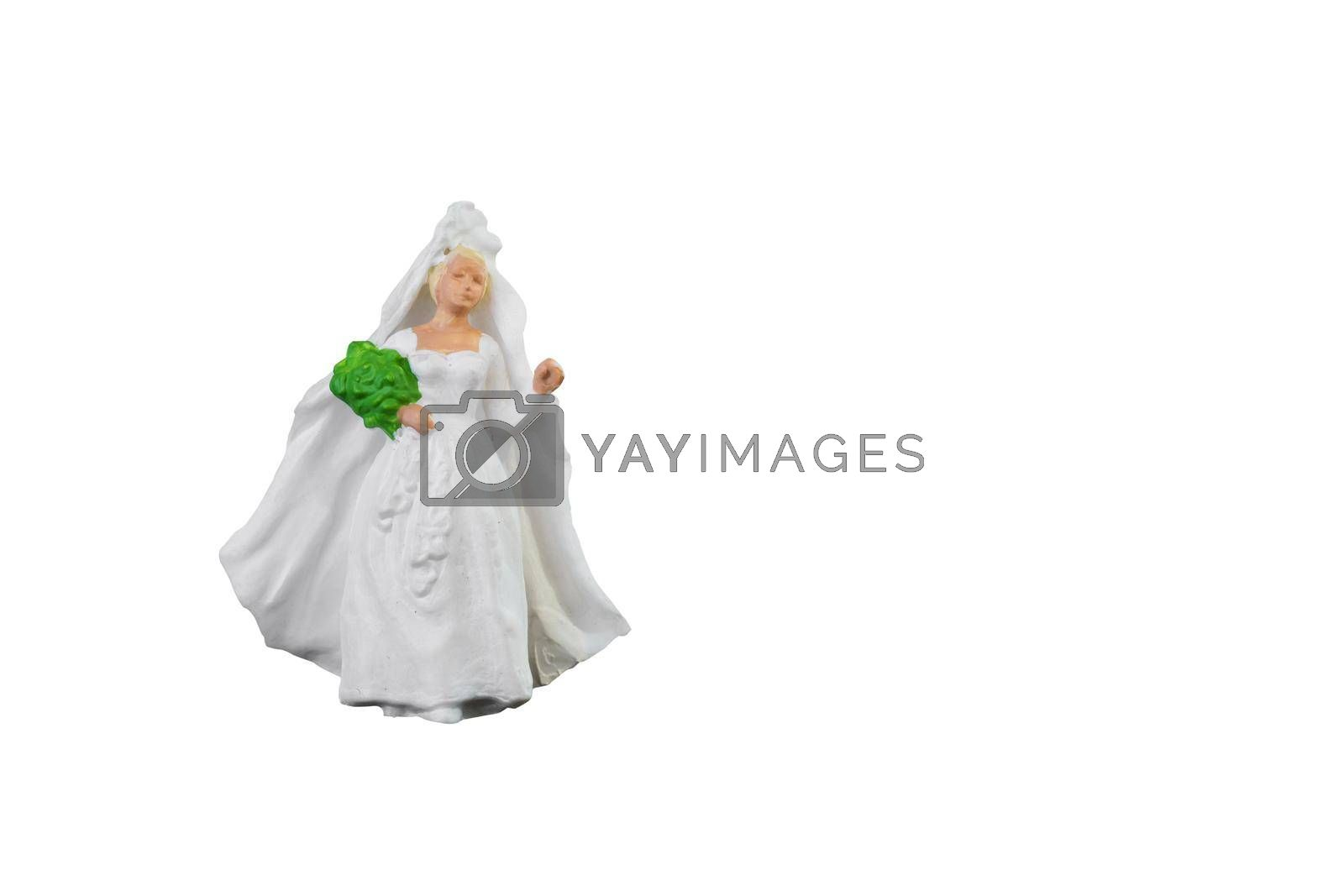Close up of Miniature people wedding bride isolated with clipping path on white background.Elegant Design with copy space for placement your text, mock up for love and wedding concept