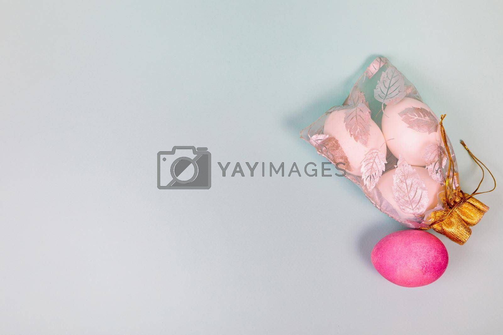 Easter. White eggs with a red egg in a bag on a uniform blue background. Place for text.