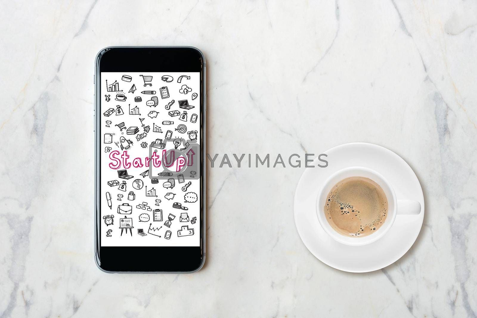 Smartphone with startup idea concept on screen with coffee cup on marble table. Elegant Design for business idea,startup business and business innovation technology.