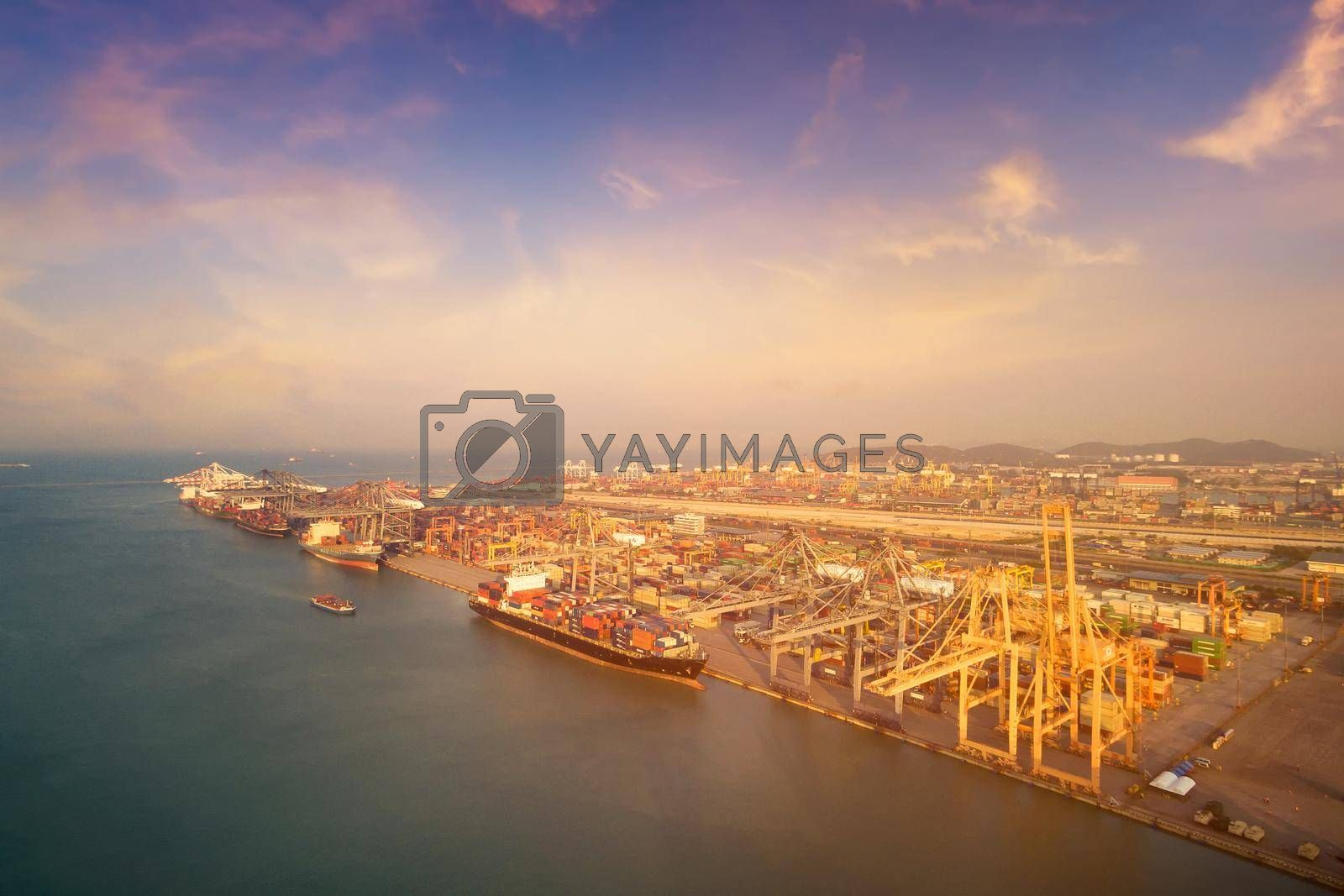 Large container shipping boat at shipping yard main transportation of cargo container shipping. Photo concept for Global business containers shipping,Logistic,Import and Export industry