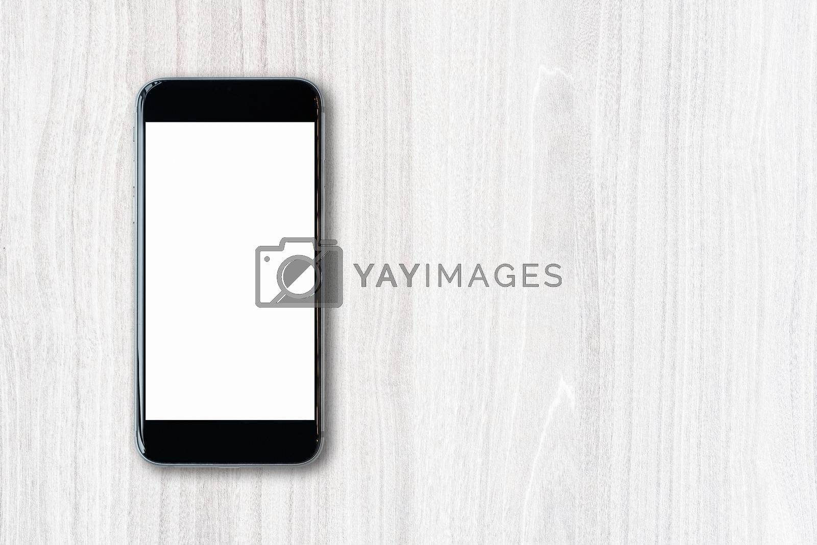 Flat lay Smartphone with blank white screen and copy-space on wood table. Elegant Design with copy space for placement your template mock up for montage your design and products