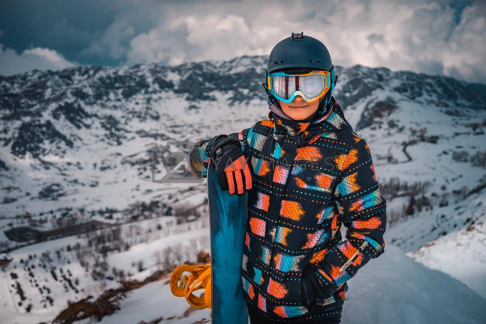 Snowboarder Preparing to Descend from the Mountain. Portrait of Happy Active Girl Enjoying Beautiful Winter Ski Resort