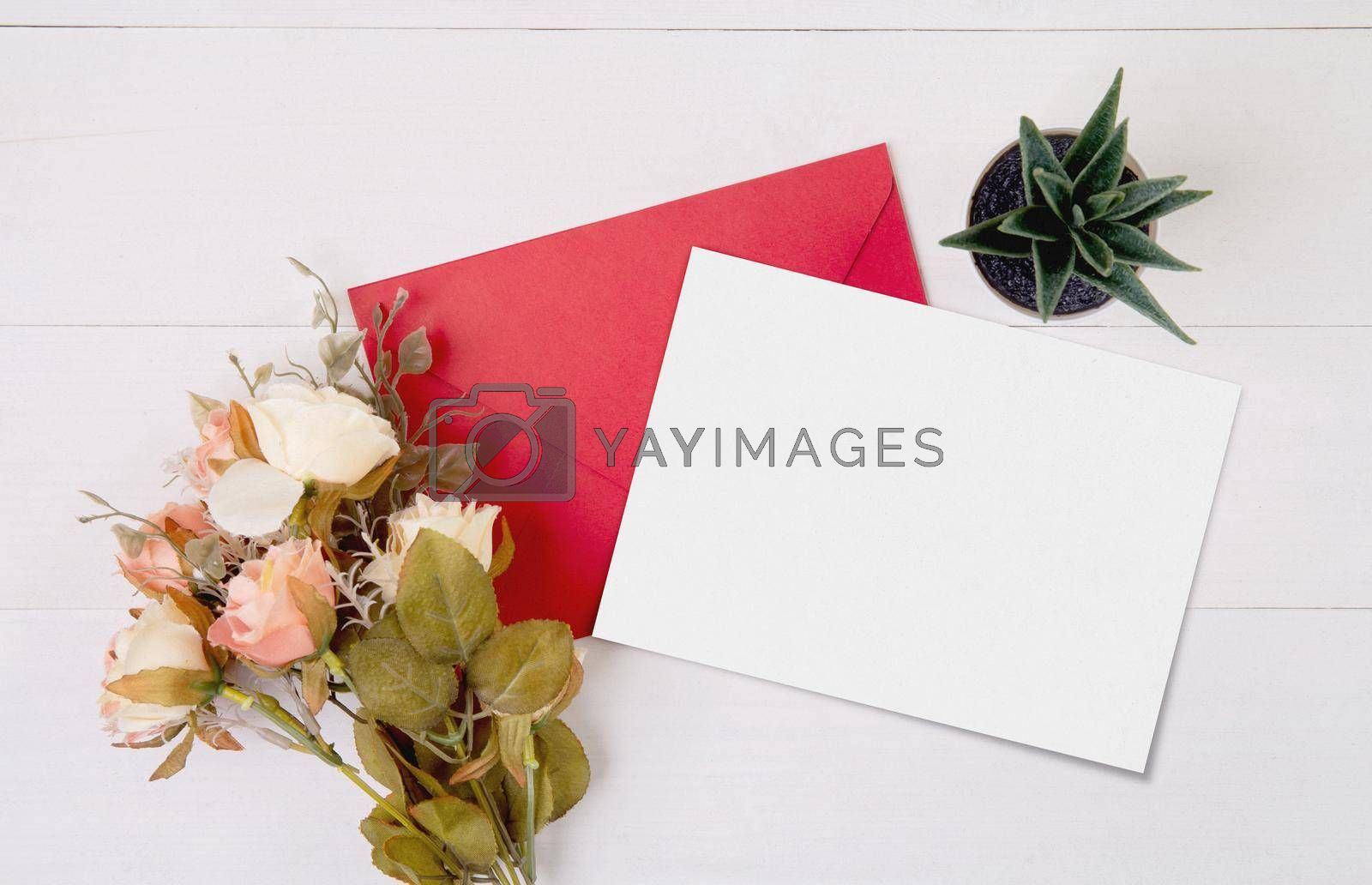 Valentine day, greeting card mockup and letter and flower on wooden table, postcard blank and gift with romance on desk, present in anniversary and celebration, top view, holiday concept.