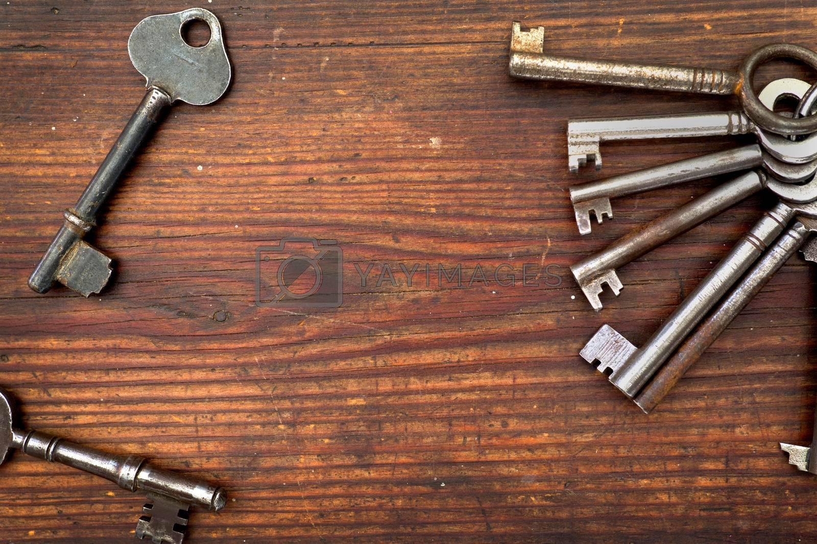 Old keys arranged on wood, flat lay