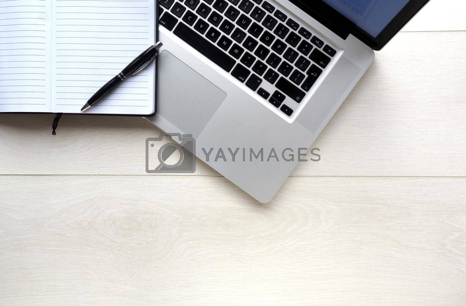 Notepad and laptop computer overhead
