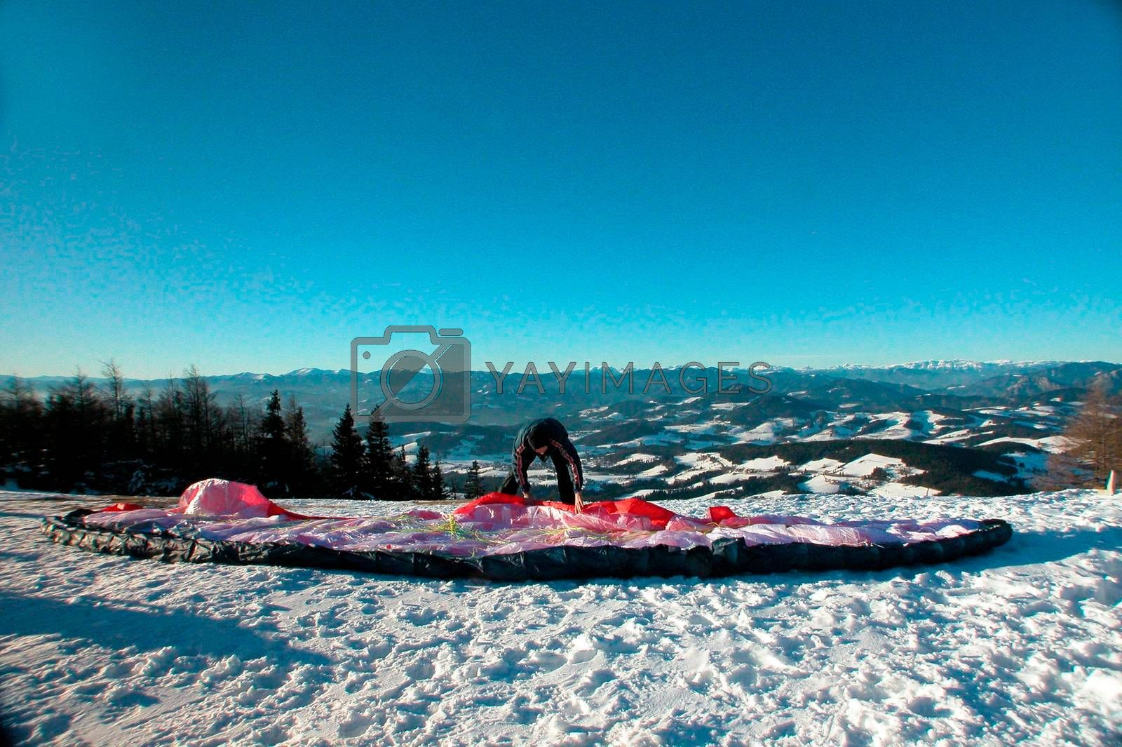 paragliding in the alps in winter, outdoor sports in the mountains