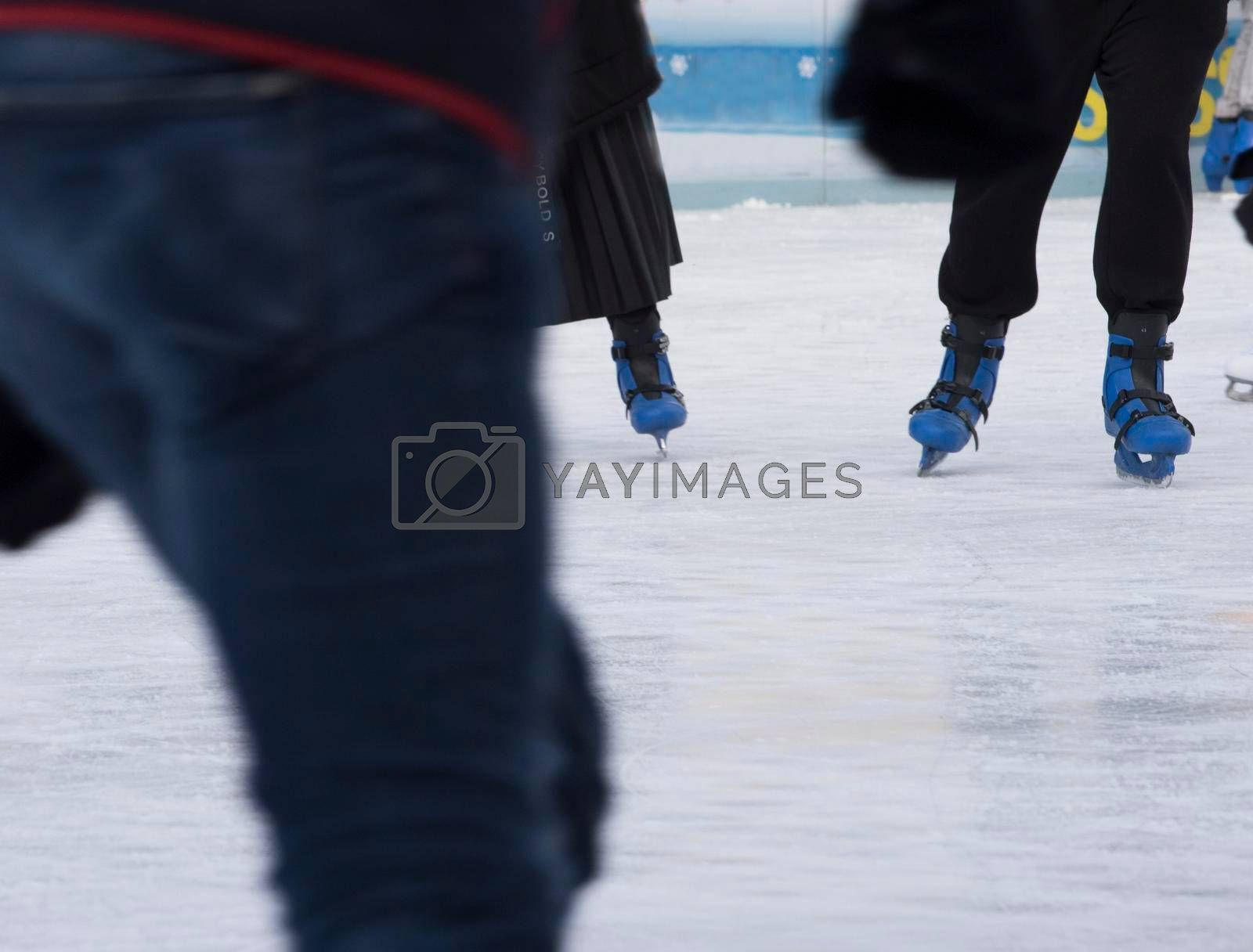 ice skating and sports in winter on a skating rink